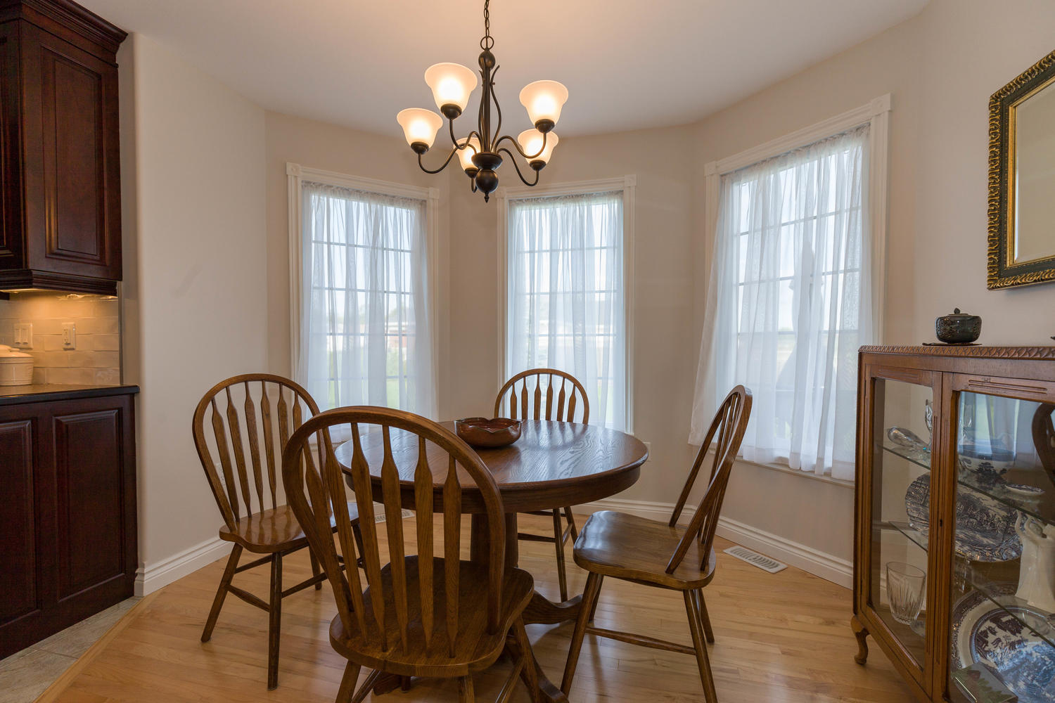 Very bright dining space with almost floor to ceiling windows just off the kitchen and overlooking the back yard.  From the morning coffee to the night cap, you'll enjoy sitting here for it all.