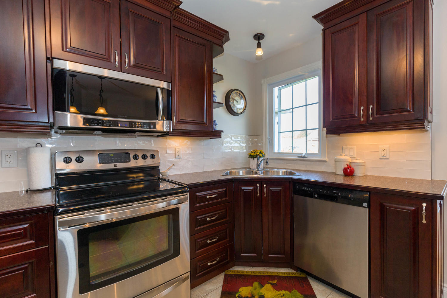 Large open and spacious.  Lots of cabinet and counter space, stainless steel appliances, great view out back from the kitchen sink.  Gorgeous breakfast bar.  Sure to impress.