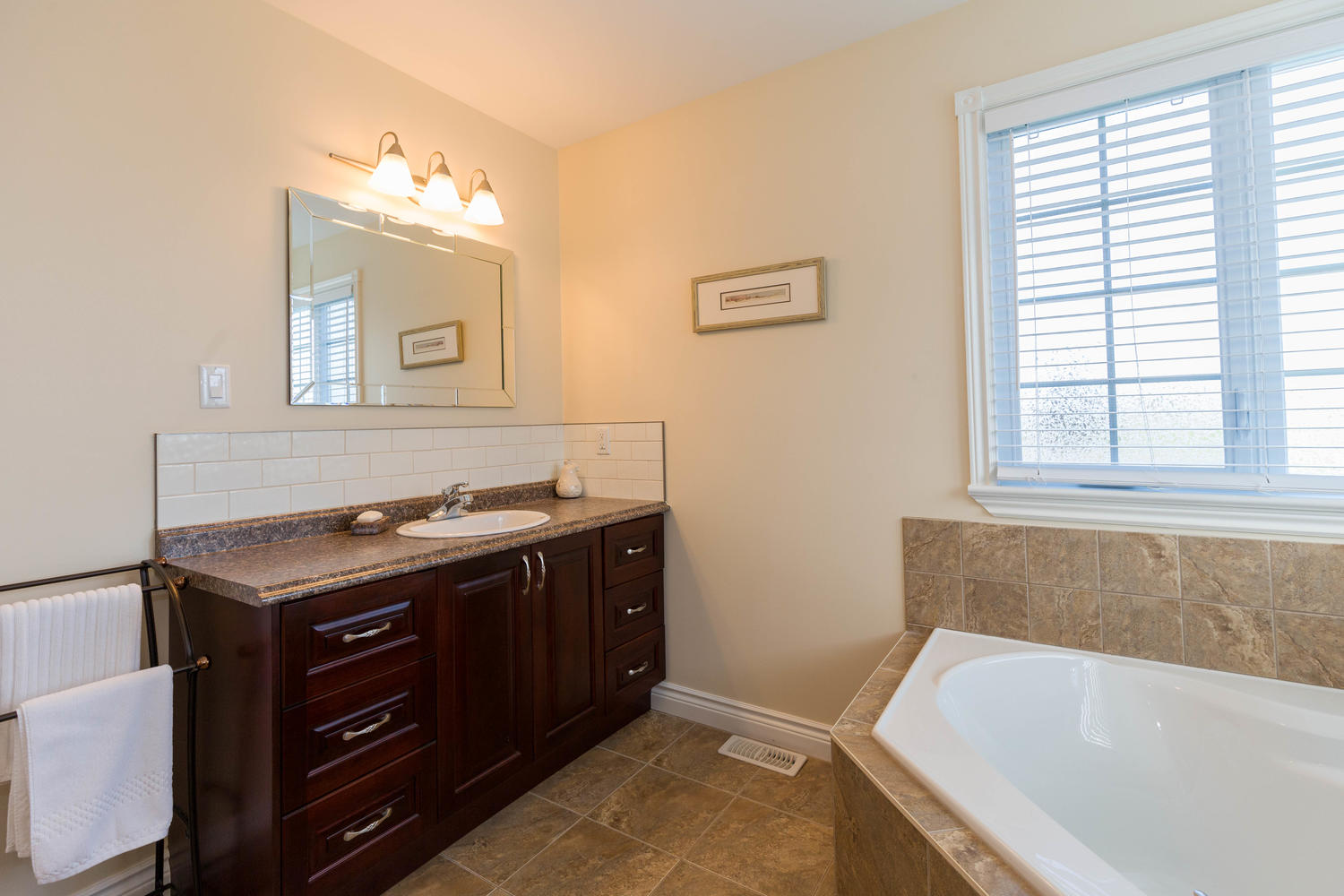 Beautiful master bathroom with a large soaker tub, gorgeous vanity, large separate shower and its very own walk-in closet.  That's right TWO walkin closets in total for the master.  HERS AND HERS!