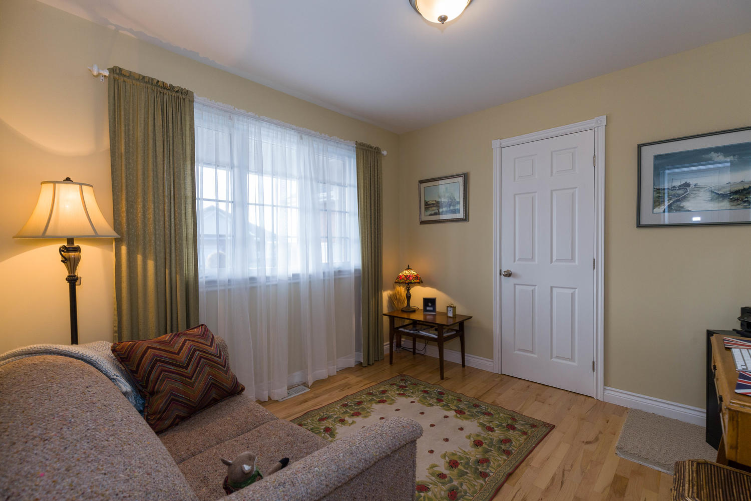 The smallest of the 3 main floor bedrooms.  Perfect space for an office as well.