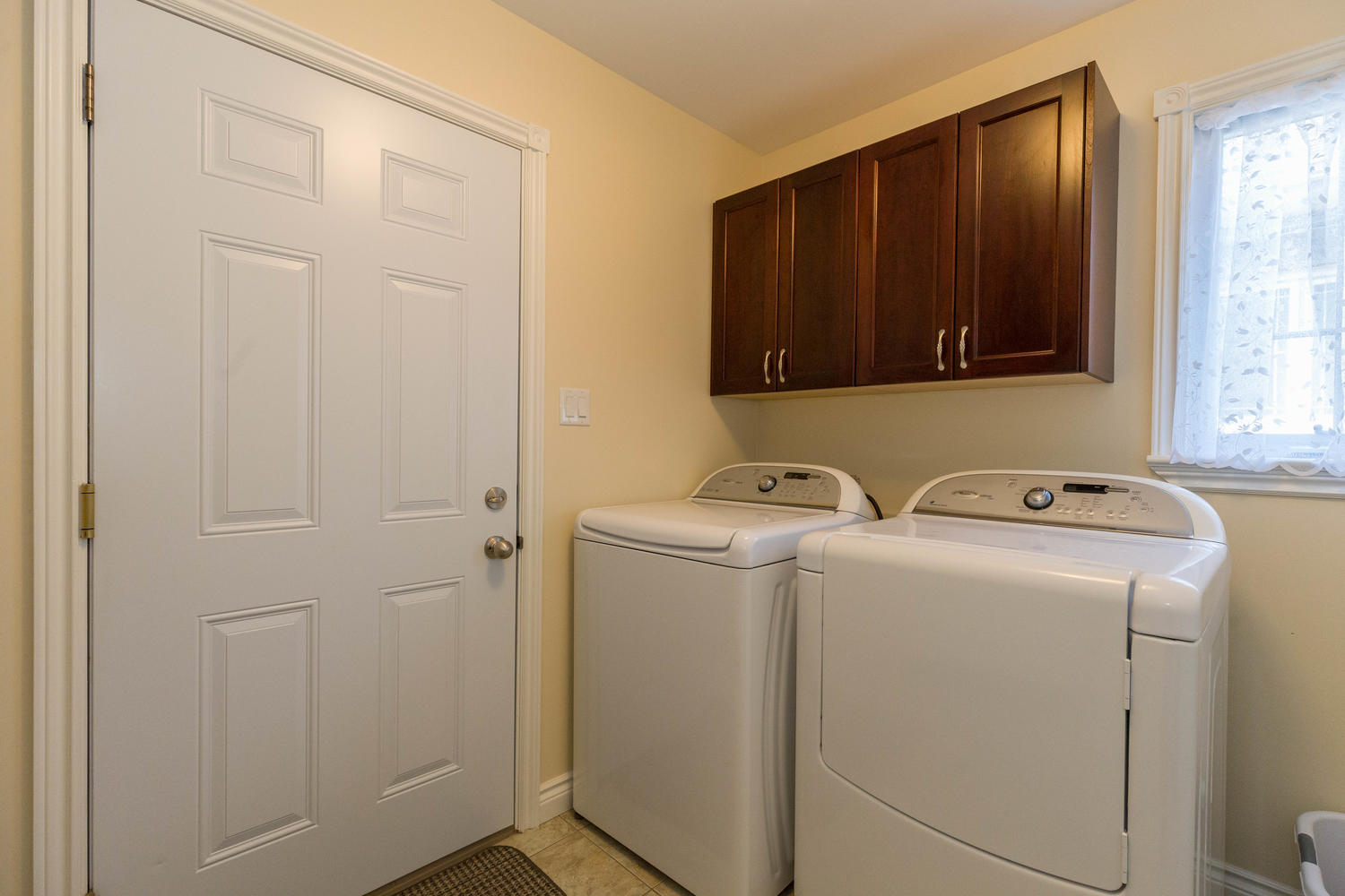 Located in the mud room between the kitchen and the garage.  Great sized laundry room.
