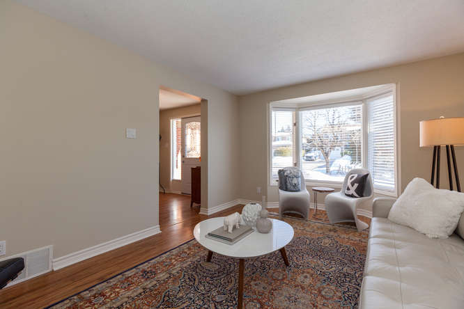 Located on the main level sits a large living room that is just soaked with sun from large bay window.