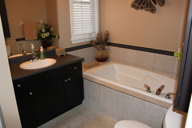 In the Master ensuite you will find a nice relaxing deep soaker tub.  Light those candles, pour the bubble bath and enjoy!