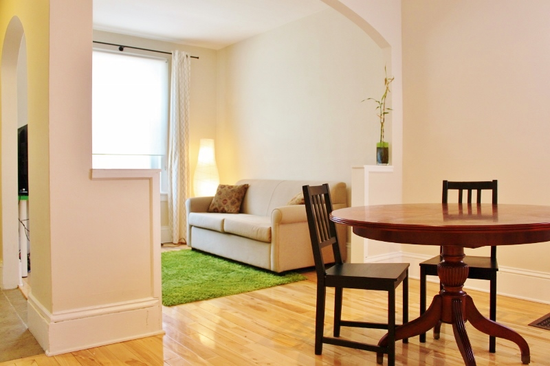 Living/ Dining space in 107, Beautiful hardwood flooring, spacious.