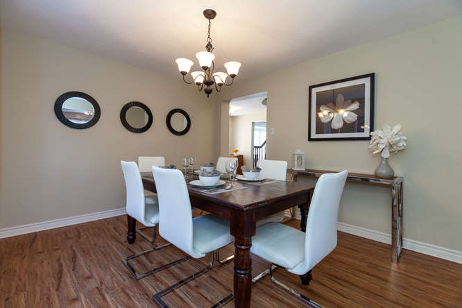 Spacious formal dining room off the kitchen that can accommodate several large pieces. New window in 2016