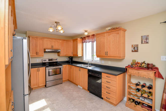 Large kitchen with dining area, loads of cabinet space and counter space.