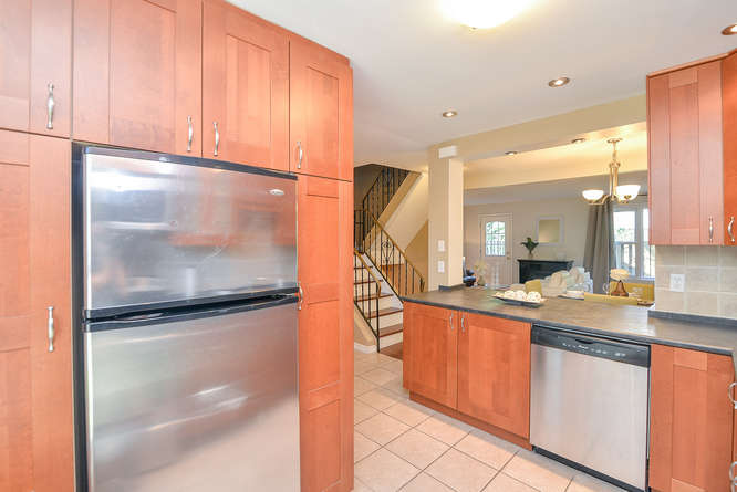 Large newer kitchen with loads of storage and counter space, stainless steel appliances.