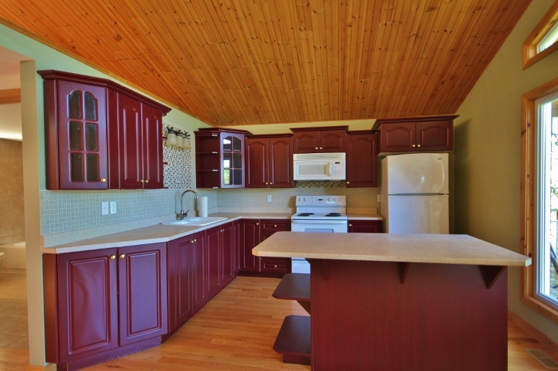 Bright and spacious kitchen with newer cabinets, lots of counter space, tasteful back splash.