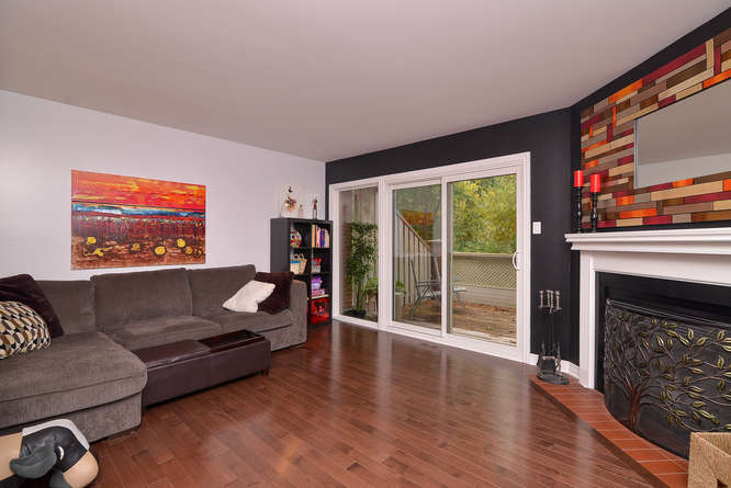 Wood burning fireplace and gleaming hardwood floors.  Great room for entertaining and living.