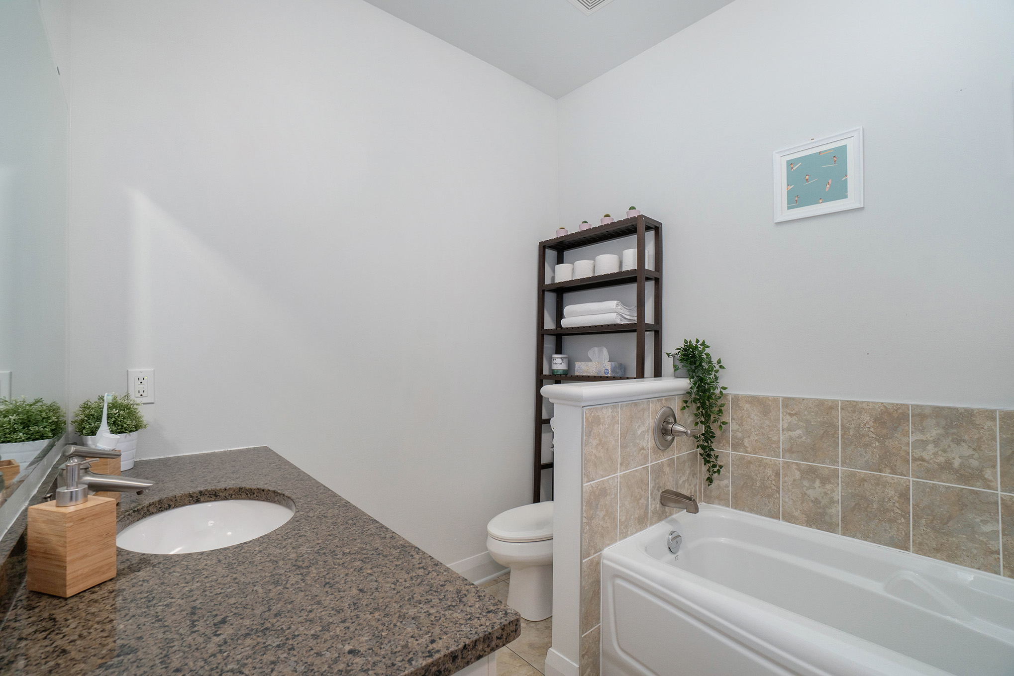 4 Piece spa like ensuite bath with large soaker tub and glass enclosed shower.