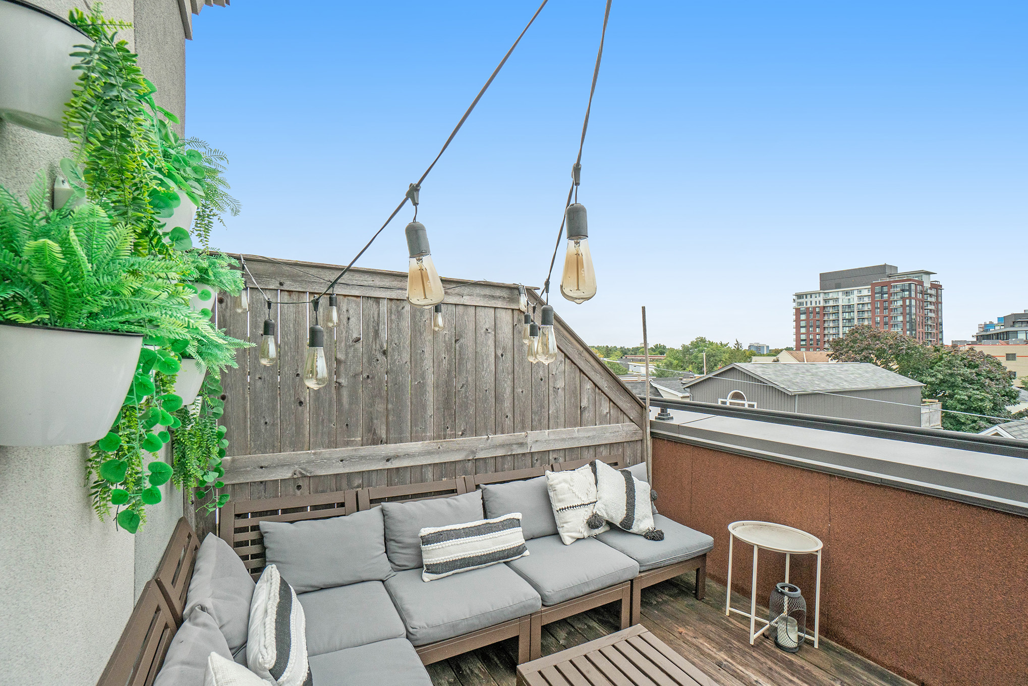 400 sqft private rooftop terrace with natural gas bbq, living and dining space, just off the master suite