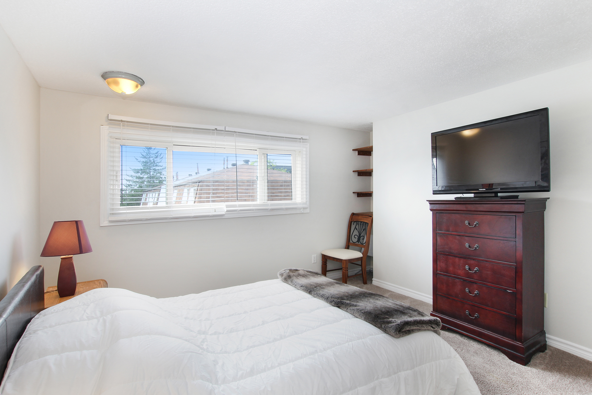 Spacious Master Bedroom, plush carpeting, Large window allowing for lots of natural light.