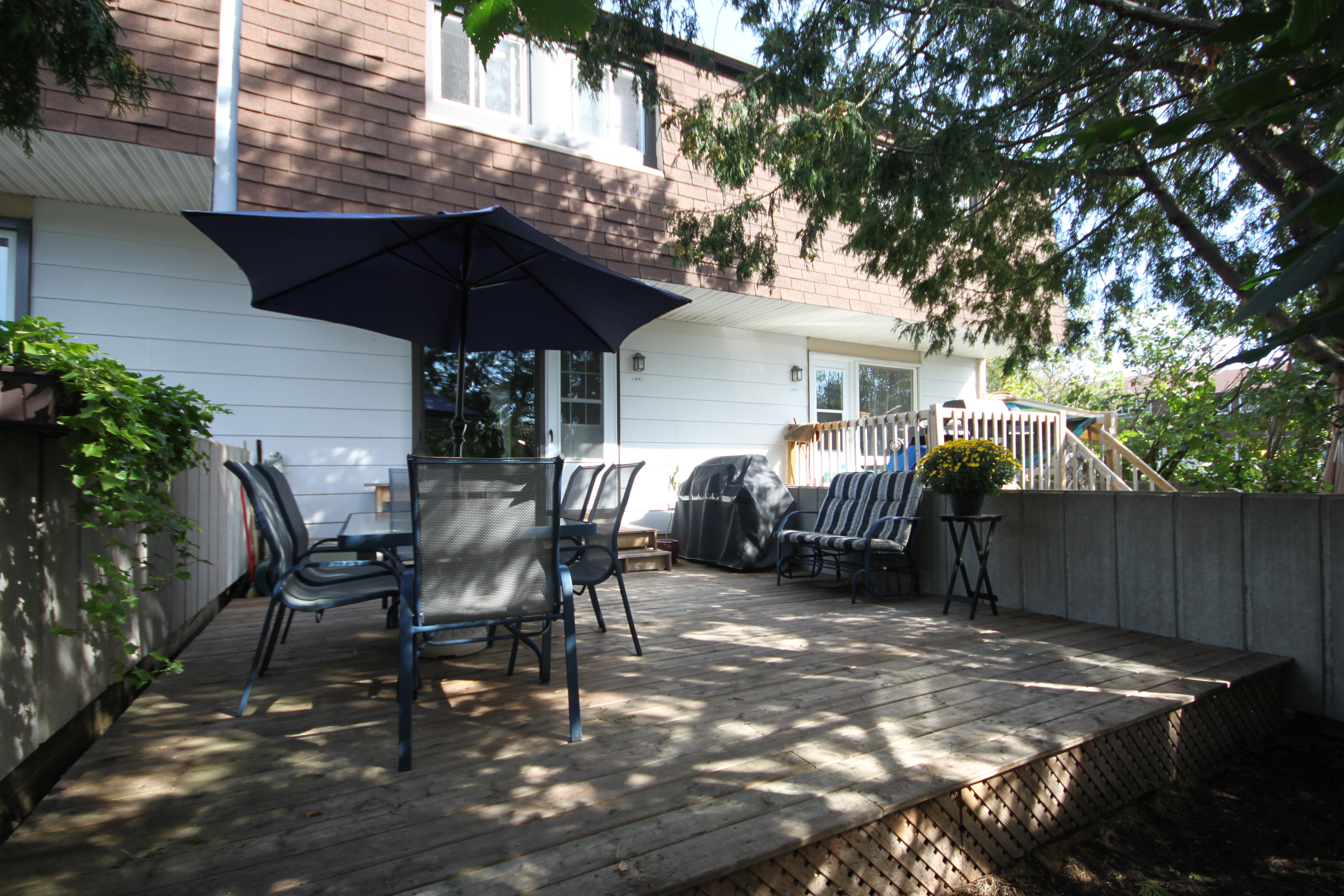 Amazing back patio with planters, lots of foliage for added privacy, and great garden area.  Perfect spot for summer entertaining.