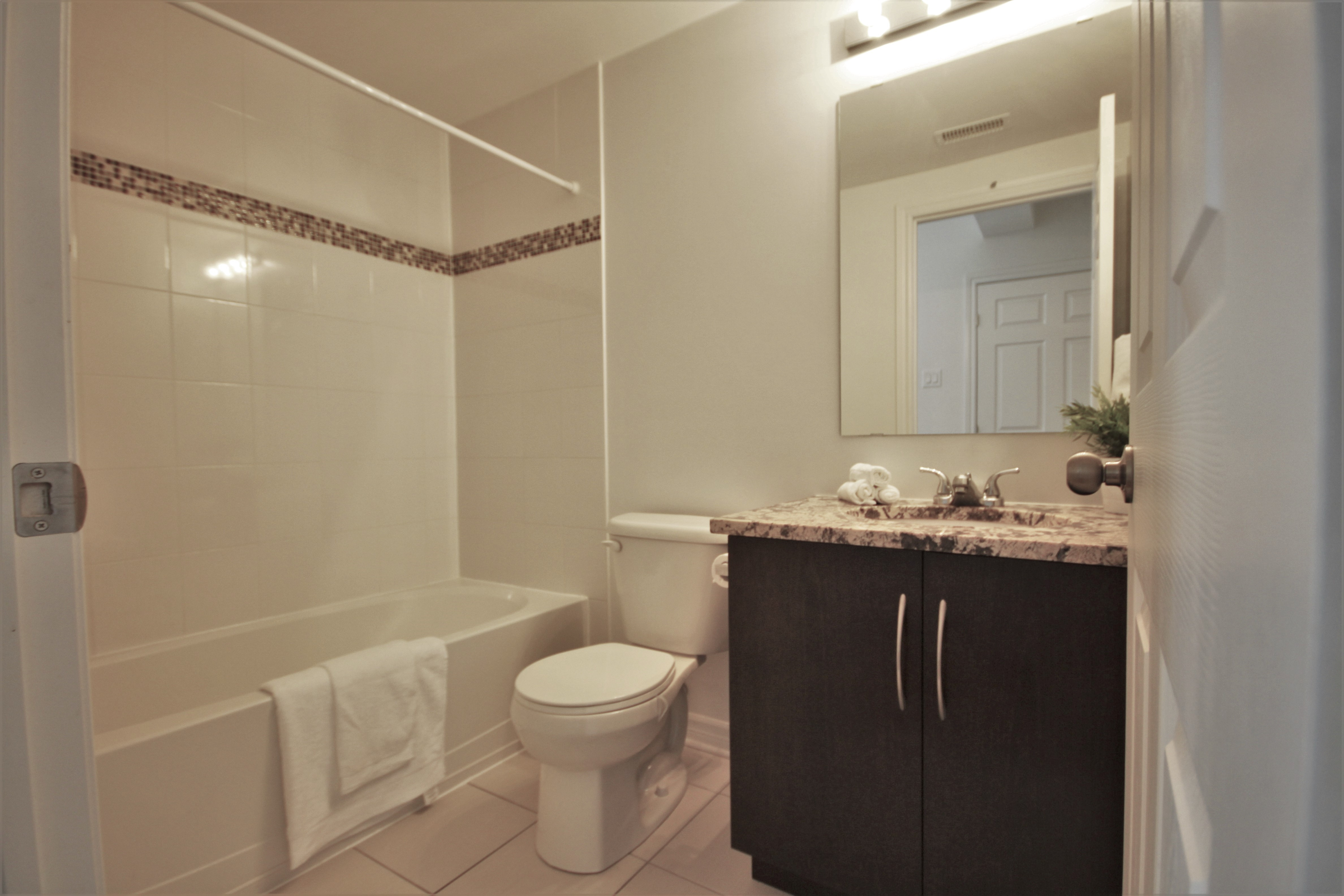 Full main bath with granite counters, ceramic tiles, bath/shower