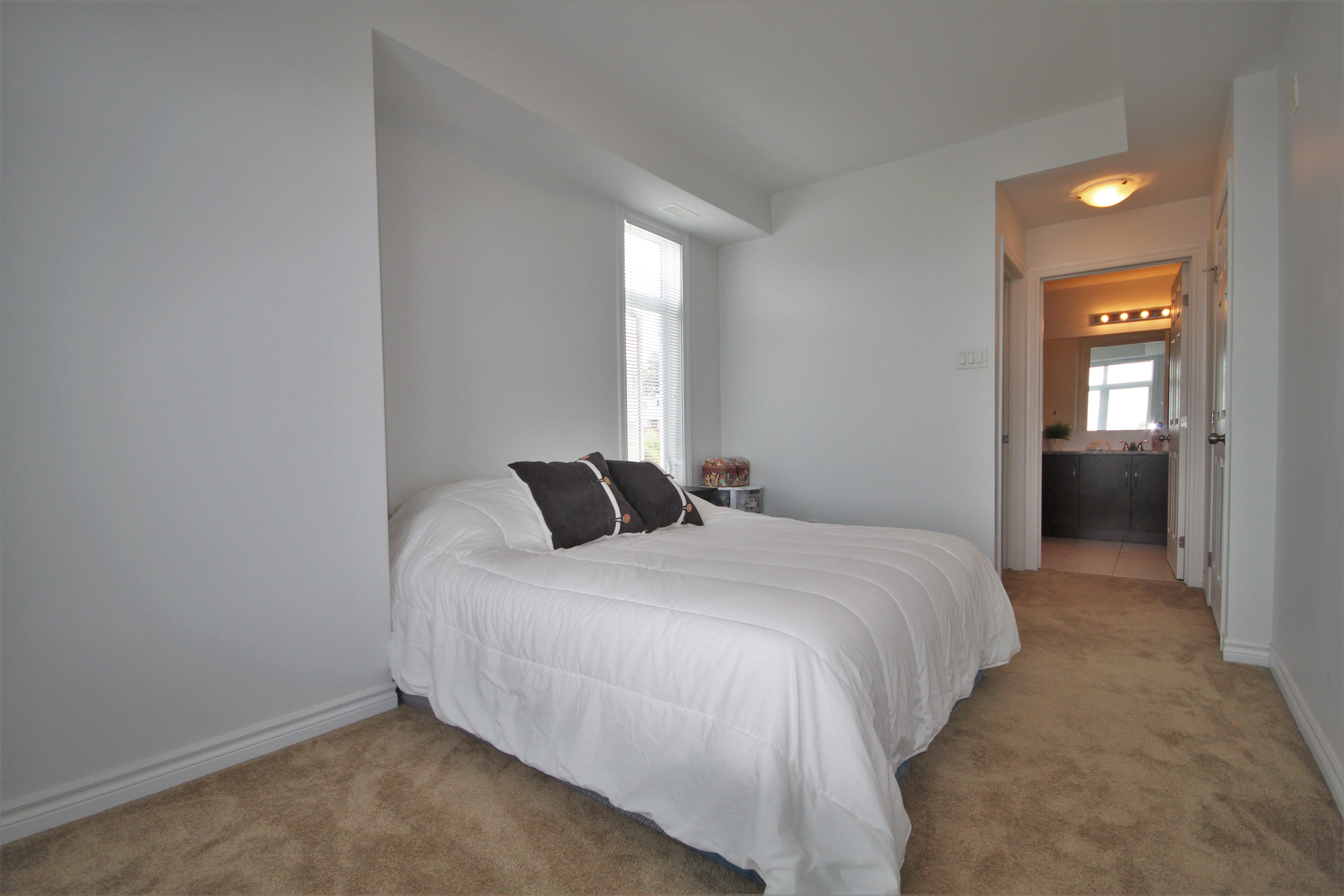 Large master bedroom with walkin closet and full ensuite bathroom.