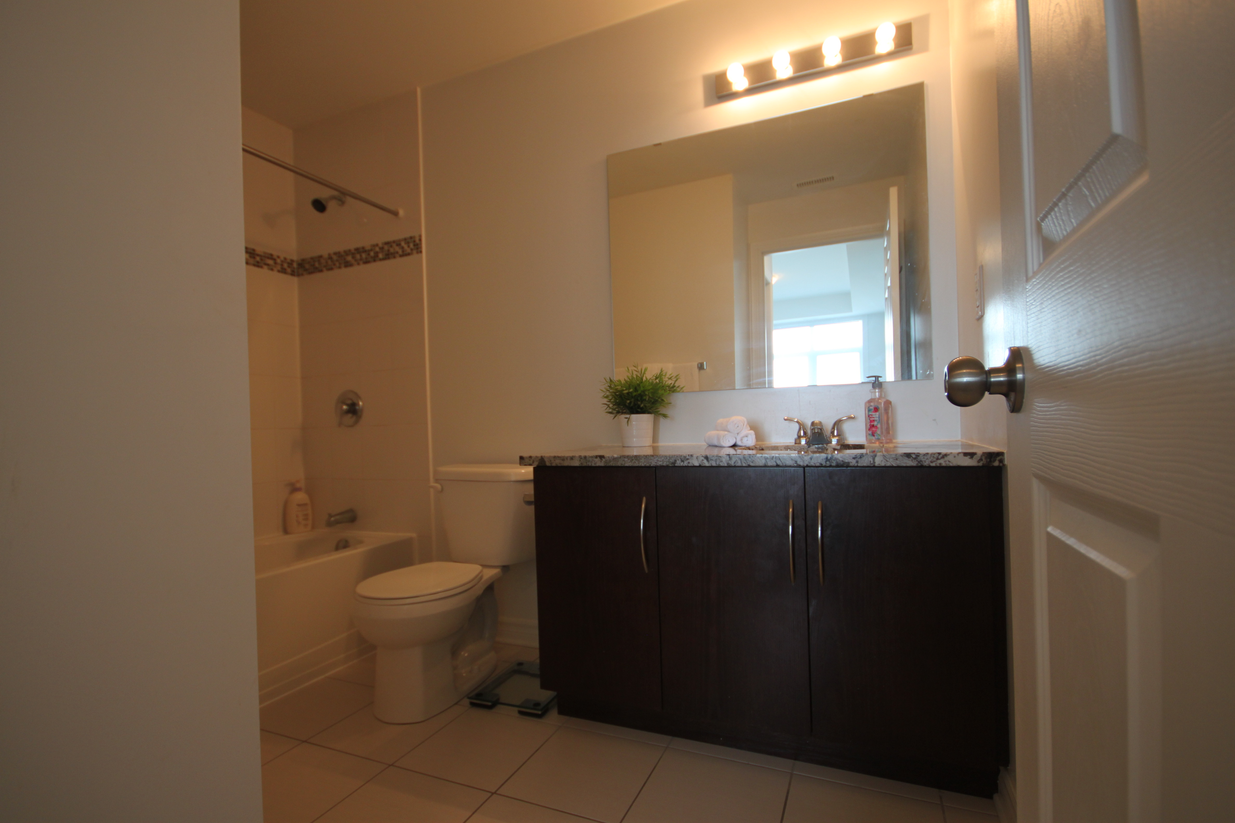 Full master ensuite with granite counters, ceramic tiles, bath/shower