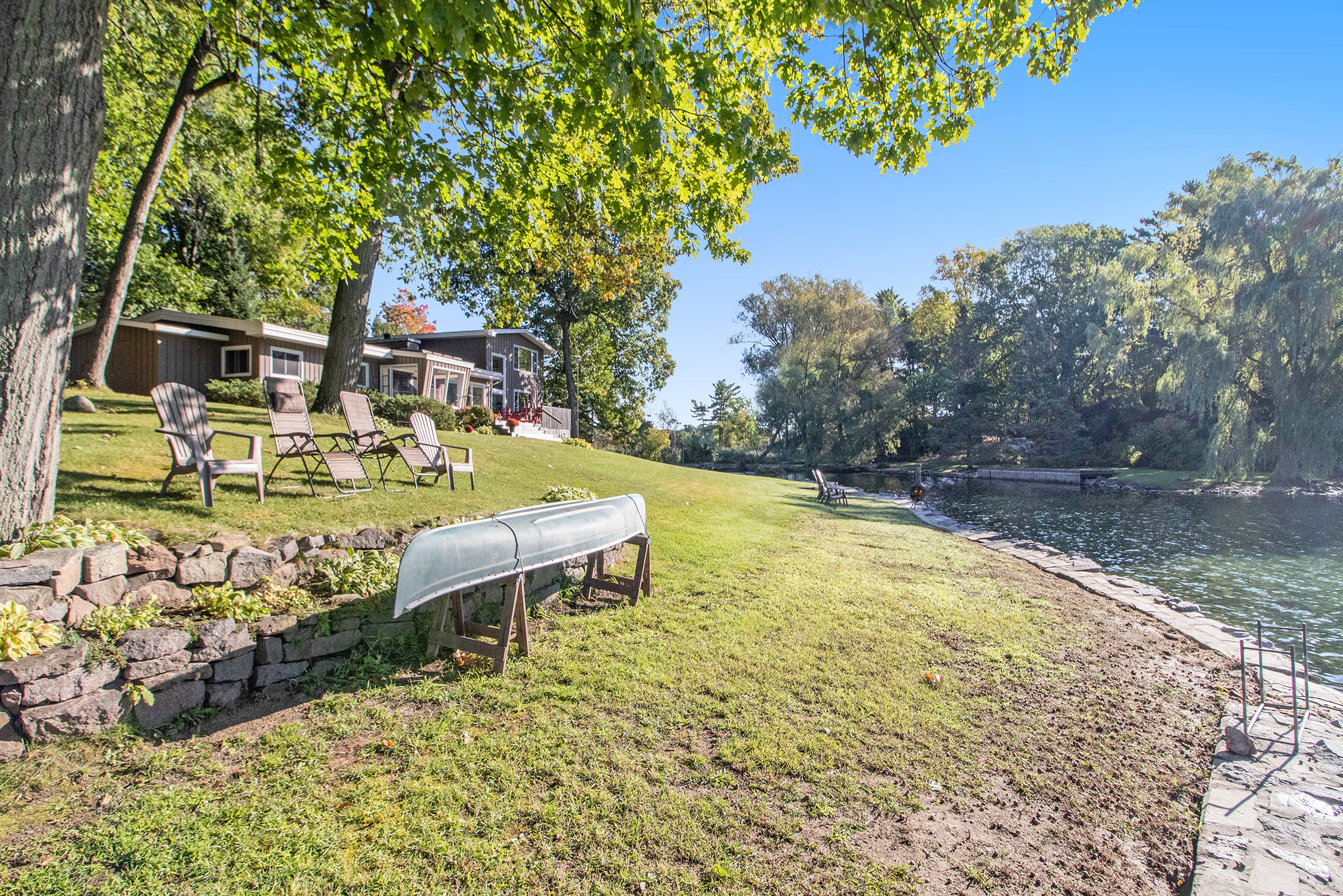 You simply can't beat this yard space down by the water.  NEVER flooded over to date, loads of grass for the kids and animals to run and play, fire pits, 40 foot dock and families of ducks and swans that come on the regular