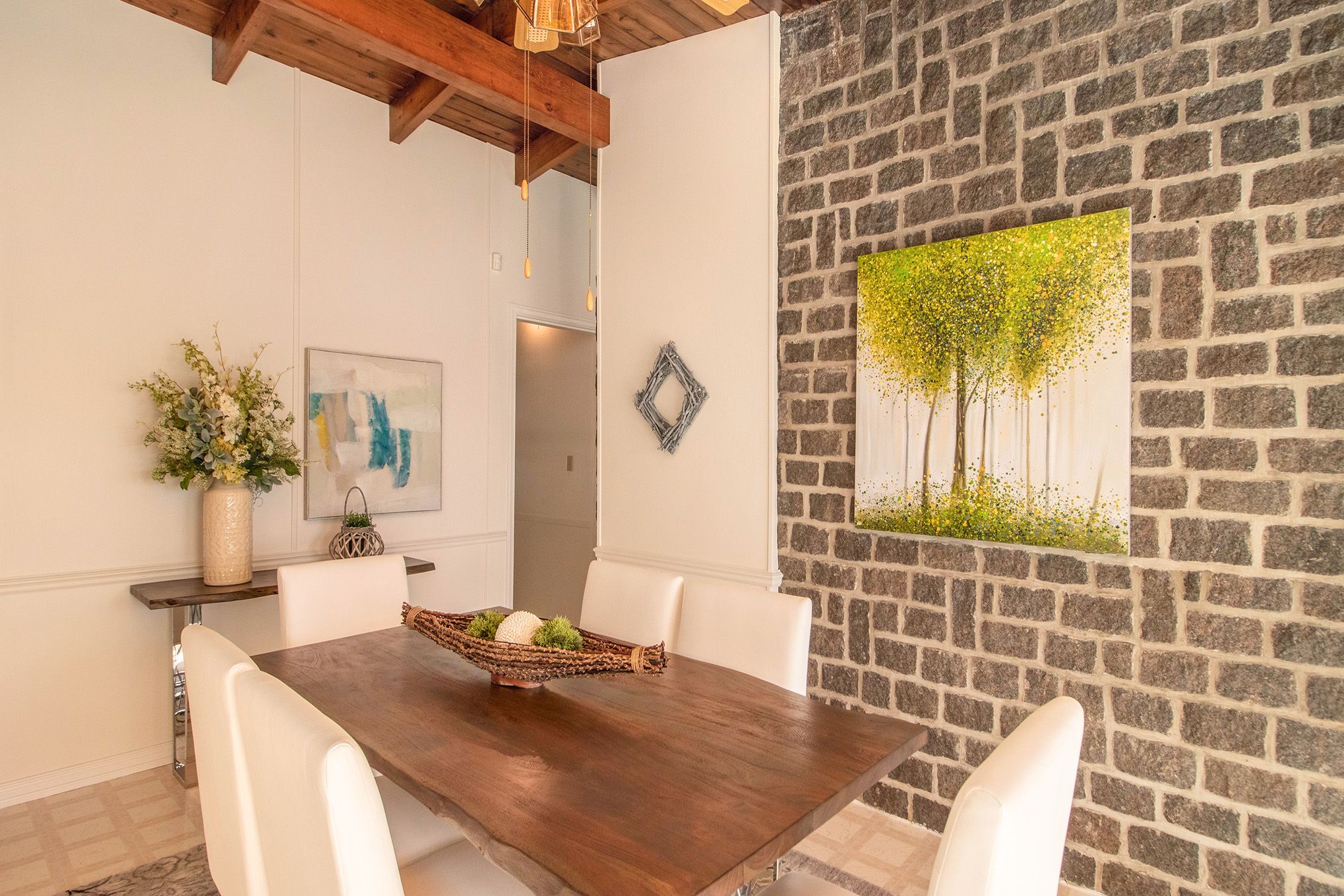 Stunning views of the water, spacious dining area with gorgeous brick accent wall, and gorgeous wooden ceilings.
