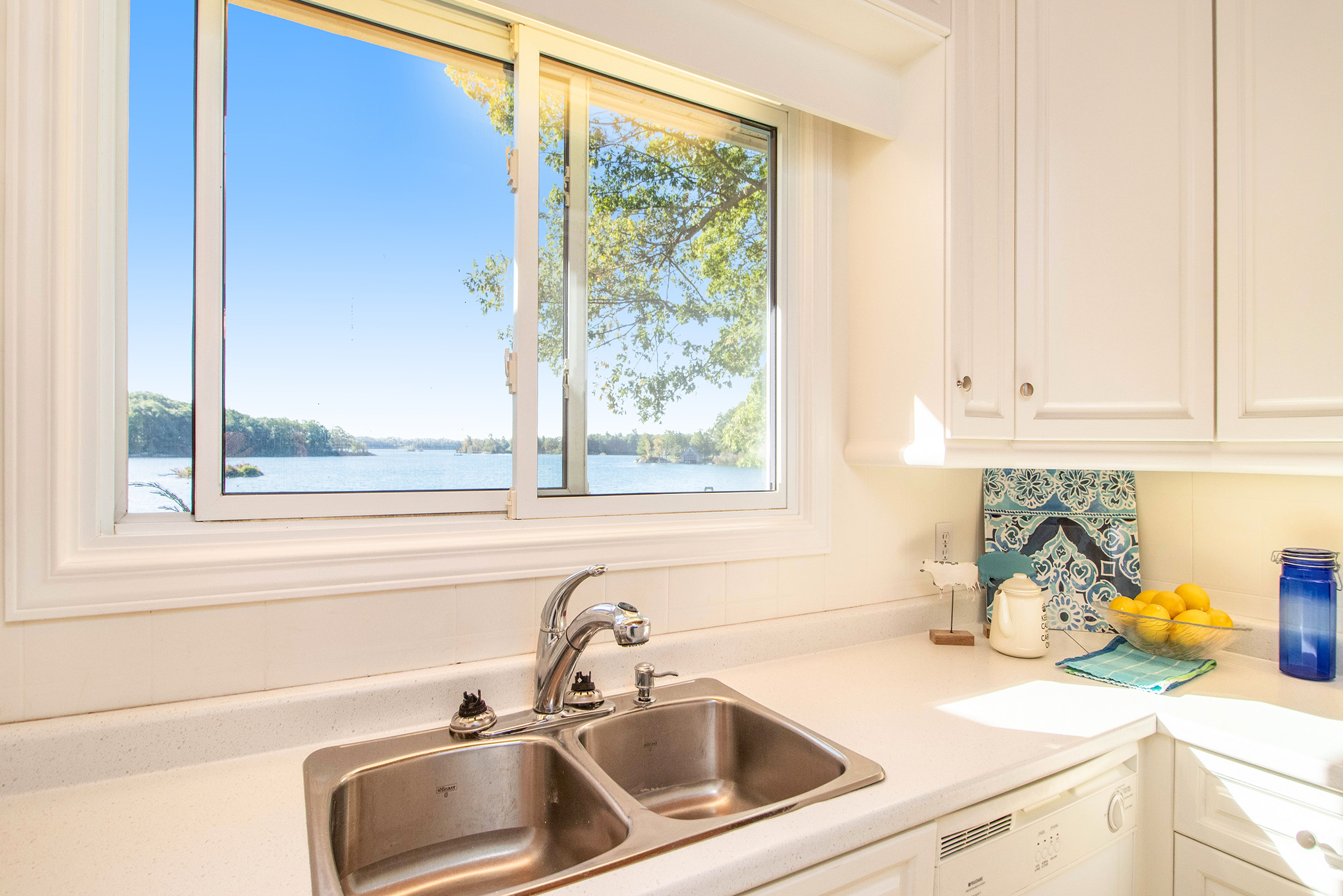 Nicely update galley style kitchen.  You will never want to stop hand washing dishes with this view.  Bright, white, and clean.  Plans on hand for your dream kitchen should this one not be to your liking...