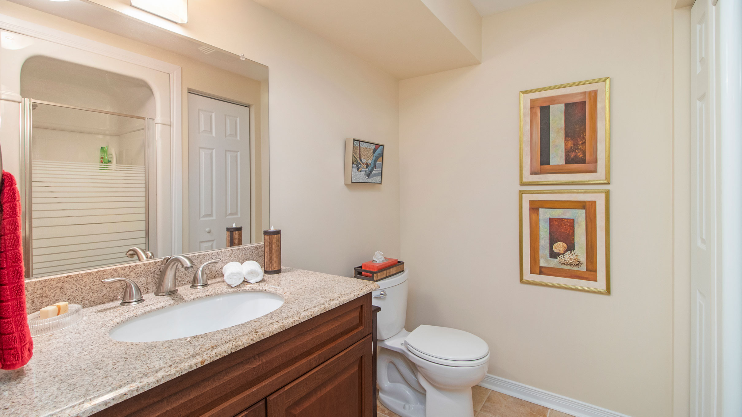 Located on the lower level this 3 piece bath with a stand up shower acts as a cheater ensutie for the large bedroom downstairs.