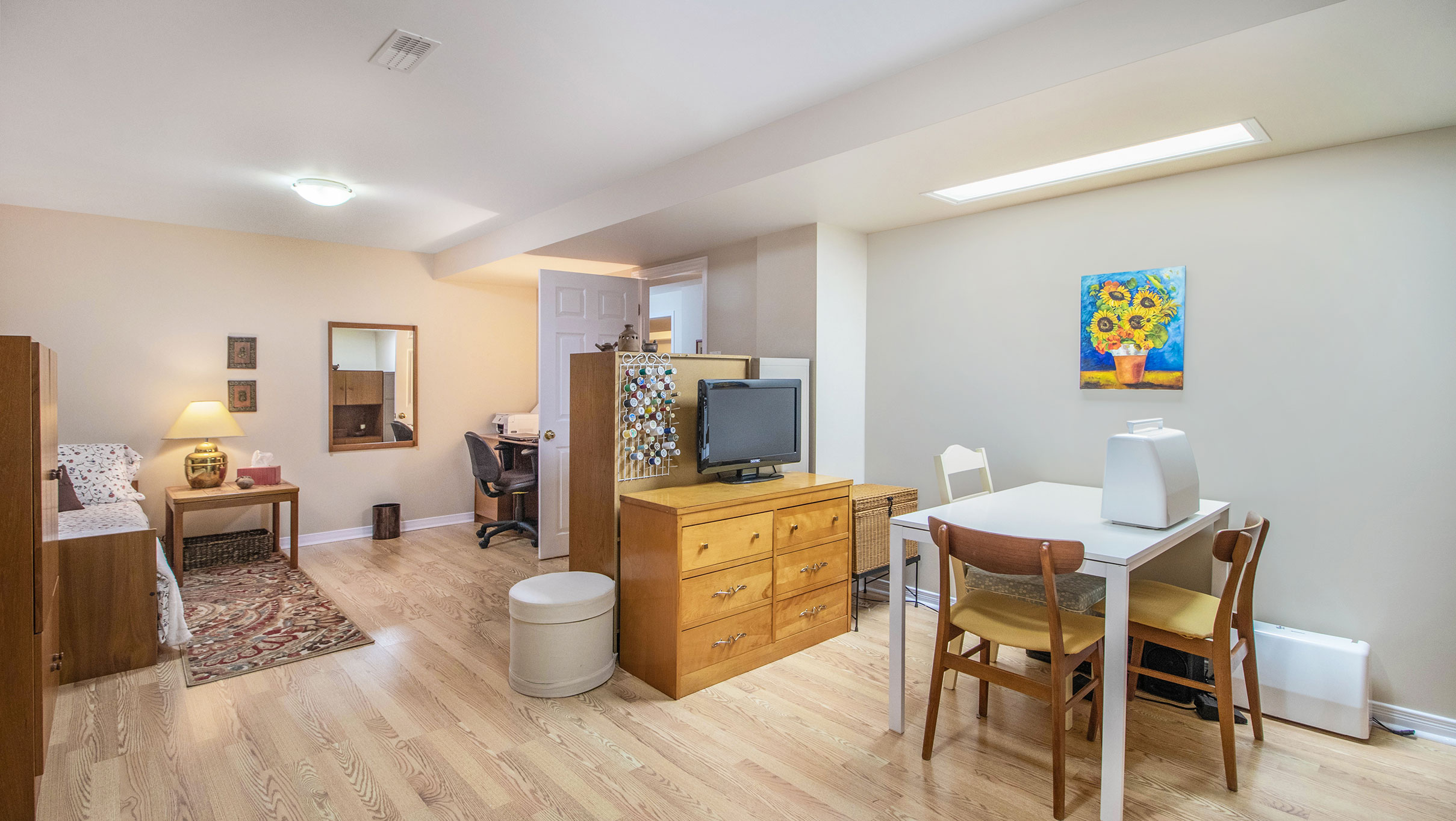 Located in the lower level, this space is typically not fully finished like this but makes for a great guest bedroom, exercise room, craft room etc.