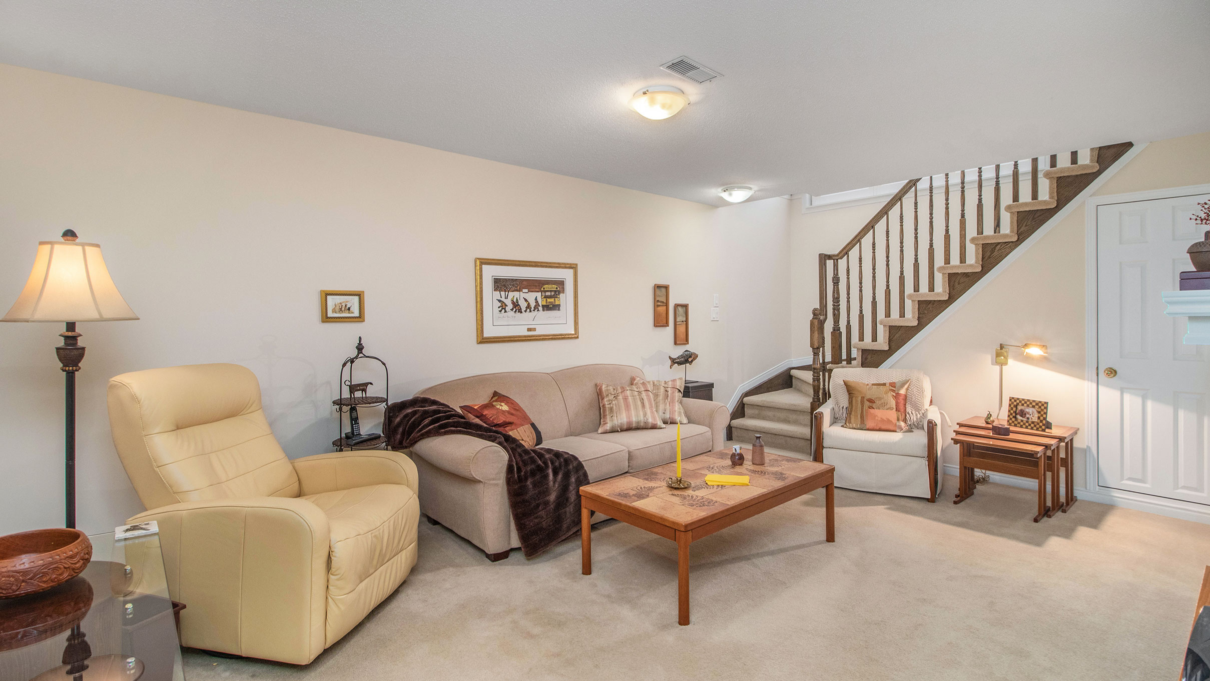 Located in the lower level, this family room is as cozy as they come with an open staircase allowing the natural light to pour through, as well as plush carpets and a natural gas fireplace for added warmth and ambiance