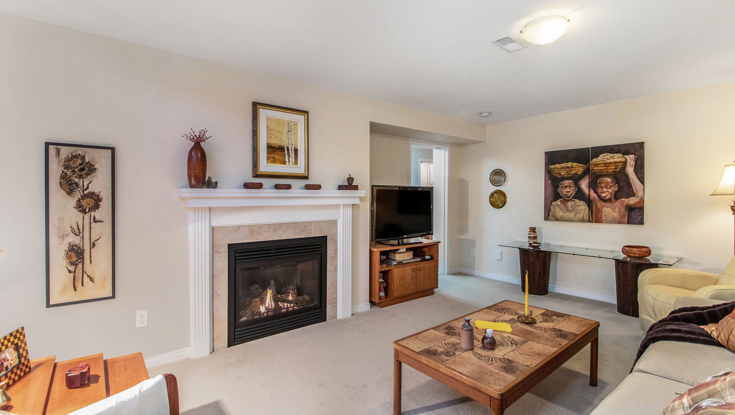 Located in the lower level, this family room is as cozy as they come with an open staircase allowing the natural light to pour through, as well as plush carpets and a natural gas fireplace for added warmth and ambianc