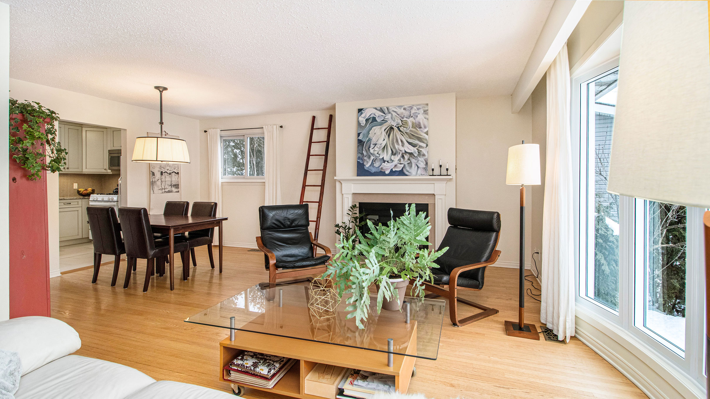 Natural light pouring in from the new bay windows, natural gas fireplace, beautiful hardwood flooring, a room couldn't be more inviting.