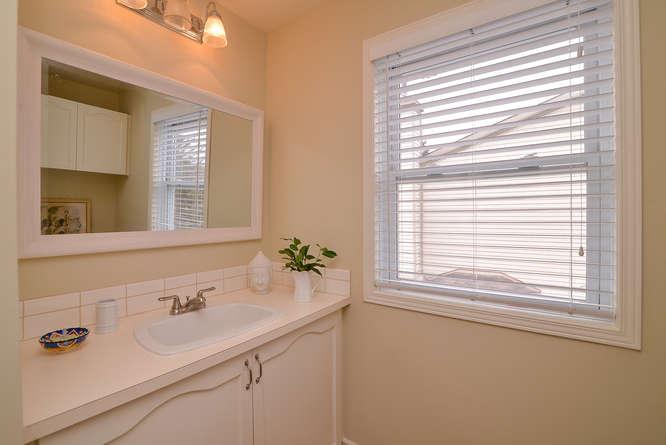 Main full bathroom on second level, ceramic tiles, shower/tub combo.