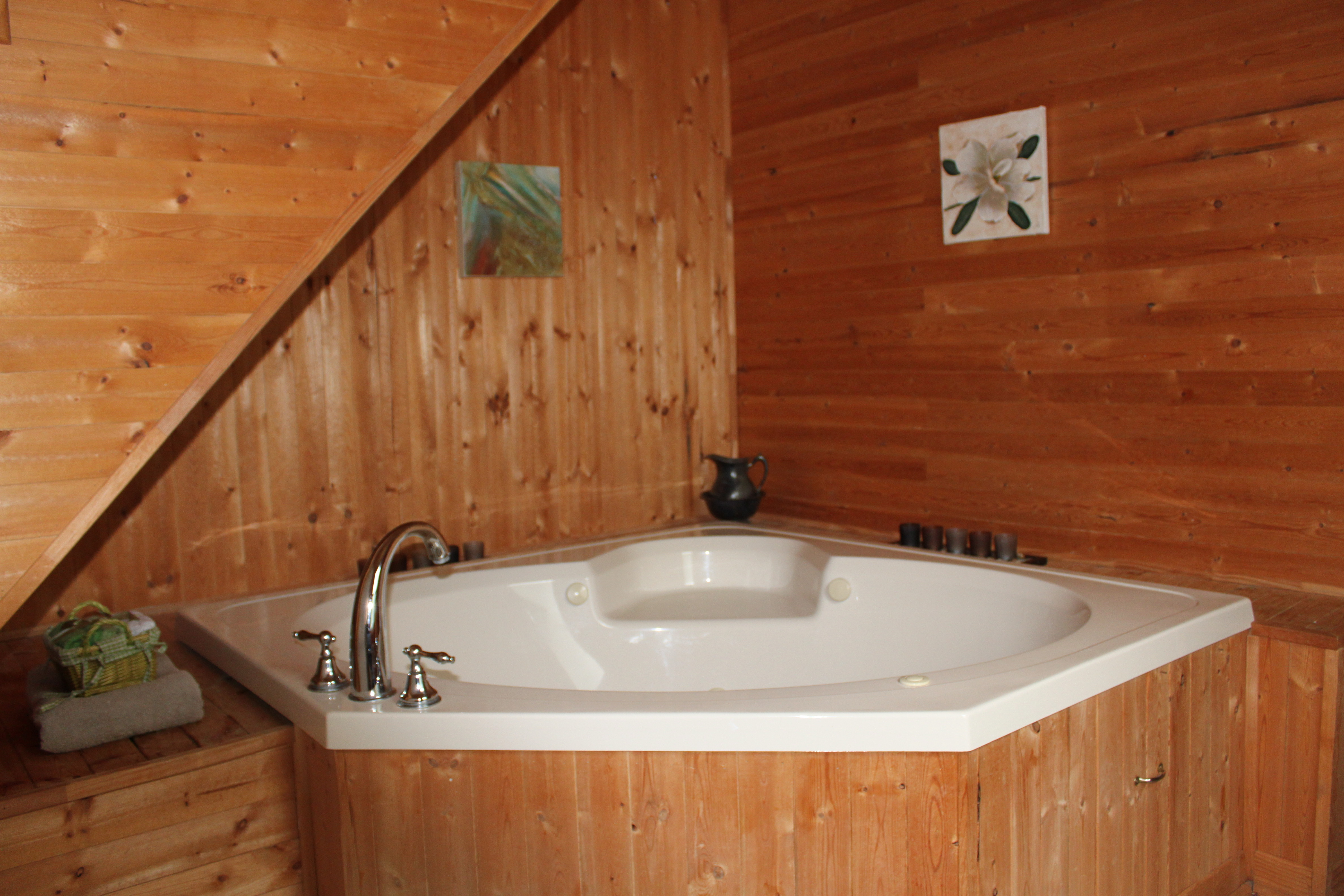 Spacious Bathroom with a Large Soaker Tub, Toilet and Sink.  All complimented with Gorgeous Wood Finishings.